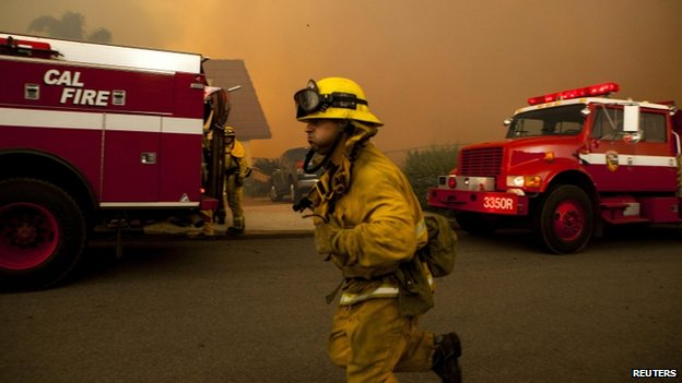 Firefighters battled the Cocos Fire in San Marcos, California, on 15 May 2014