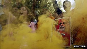 Supporters of India's Bharatiya Janata Party (BJP) hold a portrait of Hindu nationalist Narendra Modi, the prime ministerial candidate for BJP, during celebrations outside the party headquarters in New Delhi 16 May 2014