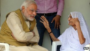 Chief Minister of western Gujarat state and main opposition Bharatiya Janata Party (BJP) prime ministerial candidate Narendra Modi (L) listens to his mother Hira Ba