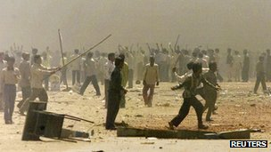 Indian Hindus riot in the smoke-shrouded streets of Ahmedabad, the main city in the western Indian state of Gujarat in this March 1, 2002 file photo