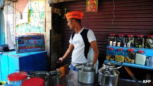 Indian tea vendor Sonu watches election result on a television at his stall in Varanasi on May 16, 2014
