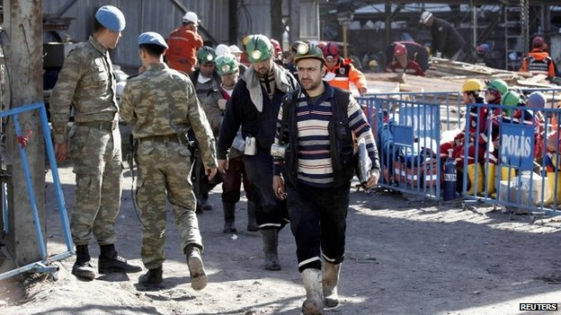 Rescuers walk towards a coal mine site after a mine explosion in Soma, a district in Turkey's western province of Manisa, 16 May 2014