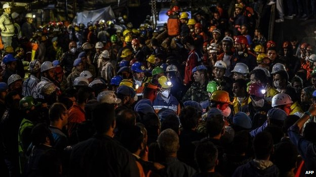 Rescuers and miners are seen as they carry out dead miners on 15 May 2014
