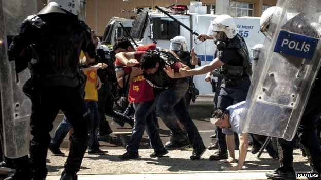 Riot police beat protesters during a demonstration to blame the ruling AK Party (AKP) government on mining disaster in Izmir, western Turkey, 15 May 2014