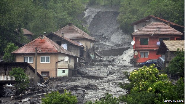 A view of a landslide and floodwaters around houses in the village of Topcic Polje, near the central Bosnian town of Zenica, on 15 May 2014