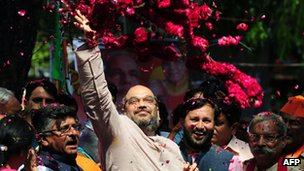 Senior leaders of the Bharatiya Janata Party (BJP) party, Amit Shah (C) and Ravi Shankar Prasad (2R) celebrate victory at their party's headquarters in New Delhi on 16 May 2014