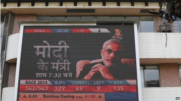 A portrait of India's next prime minister Narendra Modi is displayed on a screen on the façade of the Bombay Stock Exchange in Mumbai, India, Friday, May 16, 2014.