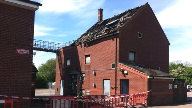 Building with roof damage caused by fire