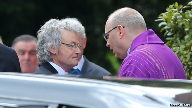Don Maguire arrives at church