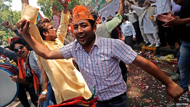 BJP supporters celebrate outside the party's headquarters in New Delhi on 16 May 2014