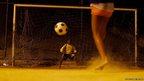 A boy kicks a penalty during a football training session at Sao Carlos favela in Rio de Janeiro
