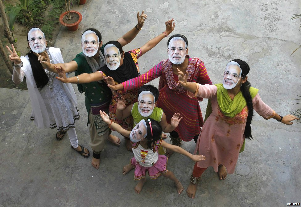 Supporters wearing masks of Hindu nationalist Narendra Modi celebrate after learning of initial poll results in the northern Indian city of Allahabad - 16 May 2014
