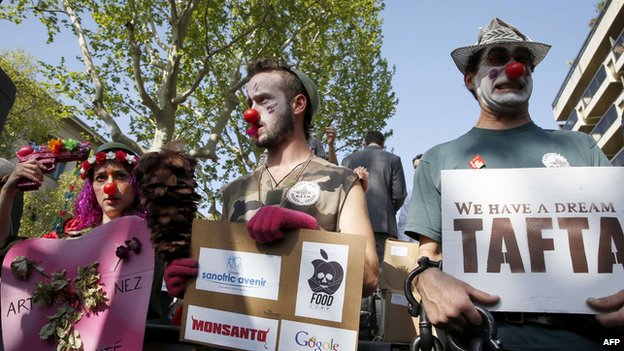 Demonstrators dressed as clowns take part in a rally against transatlantic trade agreements, Paris, April 2014