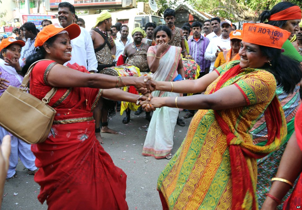 BJP supporters dance to celebrate election results outside their party office in Bangalore - 16 May 2014