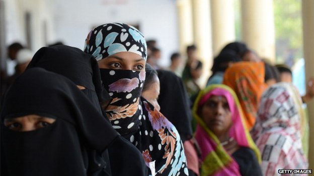 Indian Muslim women arrive at a polling station in Azamgarh, Uttar Pradesh, on 12 May 2014.