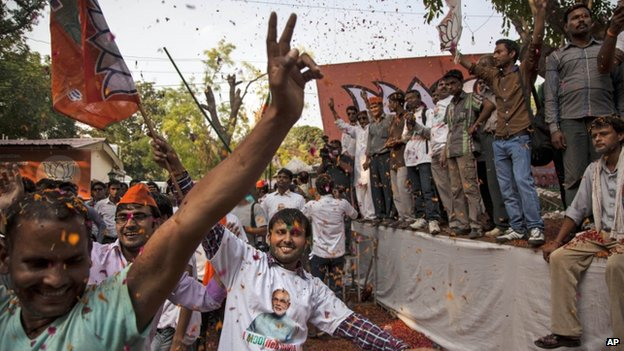BJP supporters dance to celebrate election results