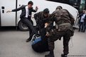A protester is kicked by Yusuf Yerkel (left), advisor to Turkey's Prime Minister Tayyip Erdogan