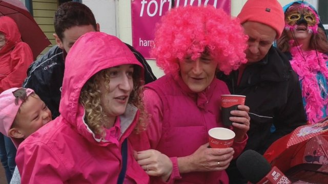 Crowds dressed in pink awaiting the Giro d'Italia in Cushendall