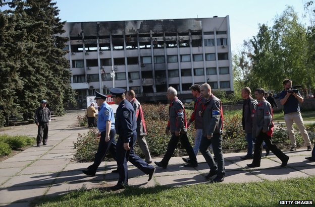 Steelworkers with police in Mariupol, eastern Ukraine, 16 May