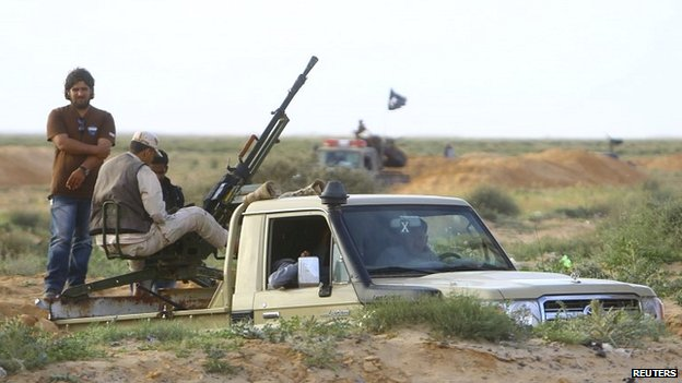 Libyan rebels on the outskirts of Ajdabiya - 22 March 2014