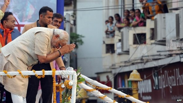 Narendra Modi bows to supporters at a rally in Gujarat - 16 May