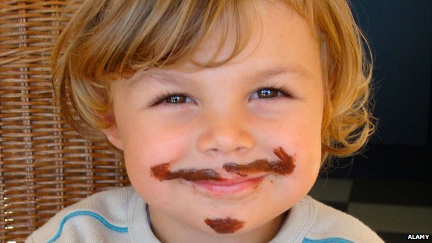 Child with nutella moustache