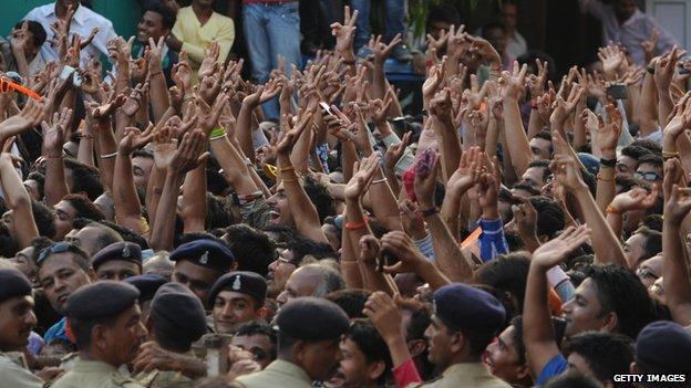 Bharatiya Janata Party (BJP) supporters cheer during a public rally by Narendra Modi