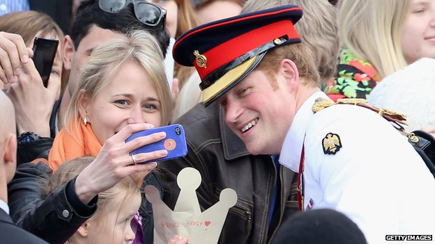 Prince Harry posing for a photograph