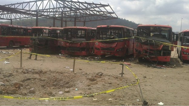 Damaged buses following blast at bus station outside Abuja on 14 April 2014