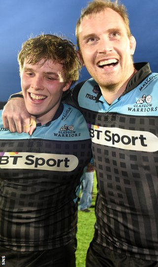 Man of the match Jonny Gray and Al Kellock celebrate Glasgow's win