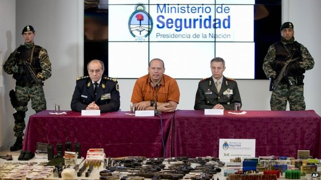 Argentina's Security minister, Sergio Berni, (centre) gives press conference