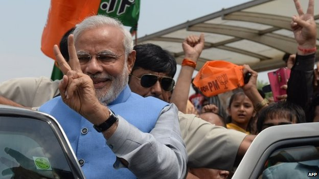 Chief Minister of the western Indian state of Gujarat and Bharatiya Janata Party (BJP) prime-ministerial candidate Narendra Modi waves as he arrives at Indira Gandhi International Airport in New Delhi on 17 May 2014