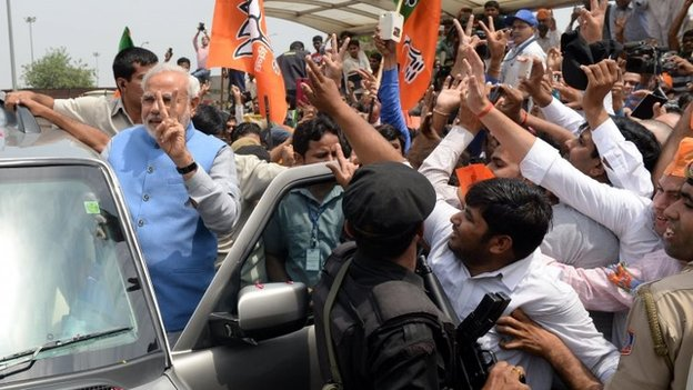 PM elect Narendra Modi waves as he arrives at Indira Gandhi International Airport in New Delhi 17/05/2014