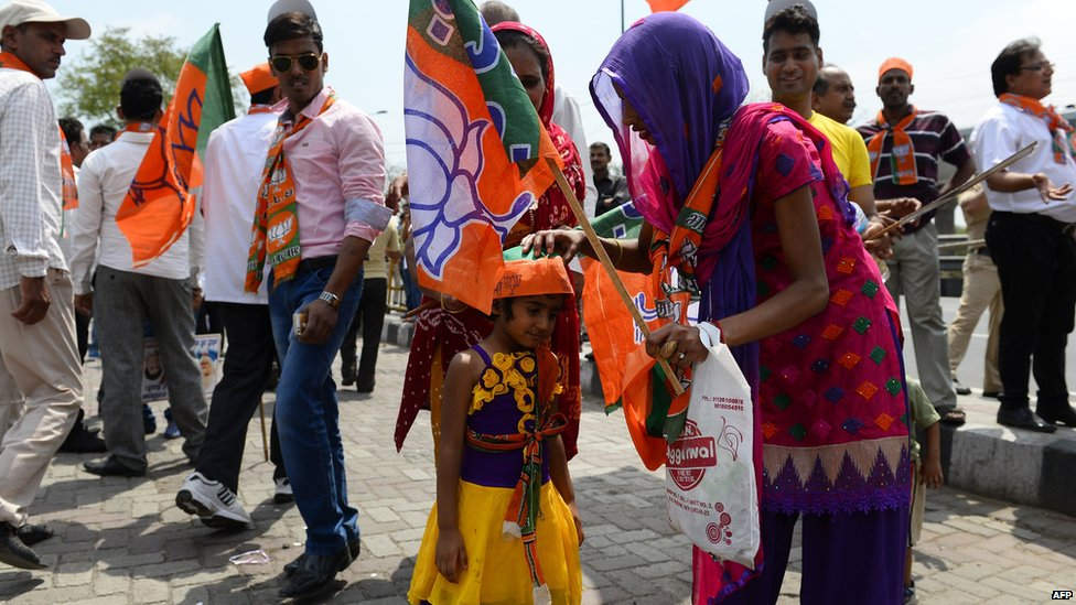 Indian supporters of the Chief Minister of the western Indian state of Gujarat and Bharatiya Janata Party (BJP) prime-ministerial candidate Narendra Modi gather ahead of his arrival in New Delhi, 17 May 2014