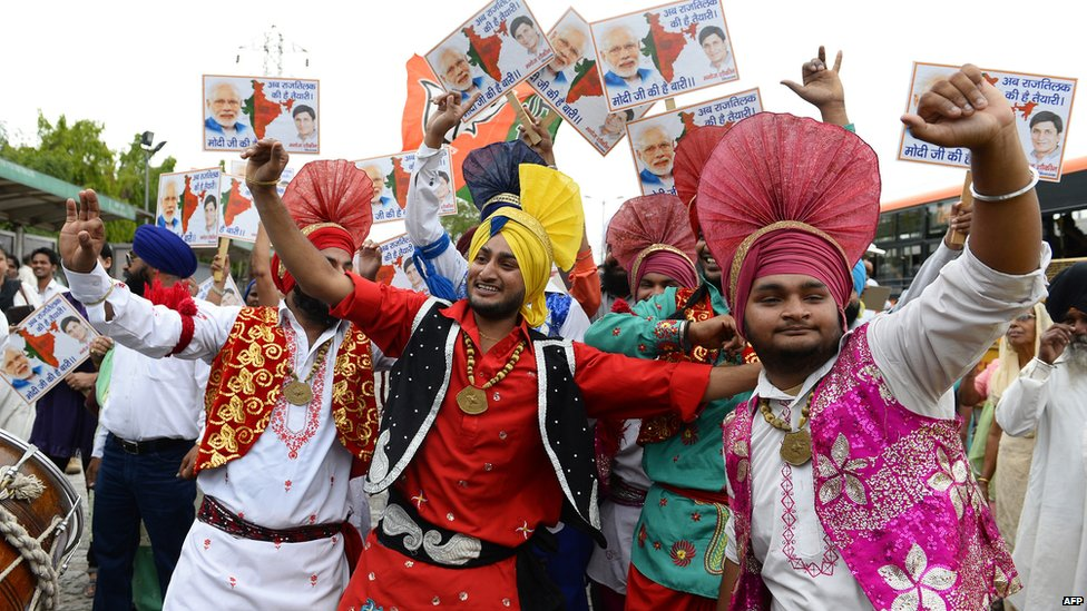 Indian artists dance as they wait for the arrival of the Chief Minister of the western Indian state of Gujarat and Bharatiya Janata Party (BJP) prime-ministerial candidate Narendra Modi in New Delhi, 17 May 2014