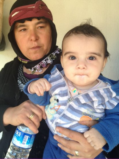 Birjan Yildarim and her seven-month-old son