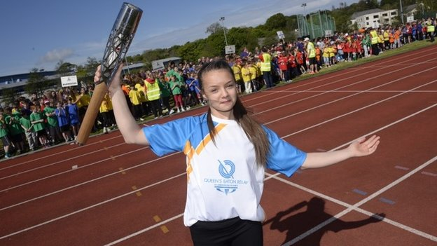 Kaitlin Kneen, 16, holding the Commonwealth Games Baton at The National Sports Centre in Douglas