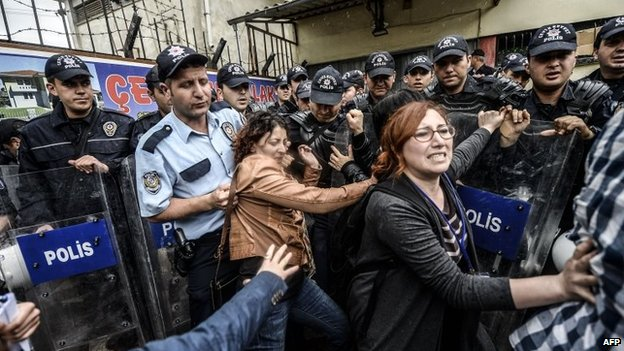 Two women push against riot police in Soma, Turkey, 17 May 2014