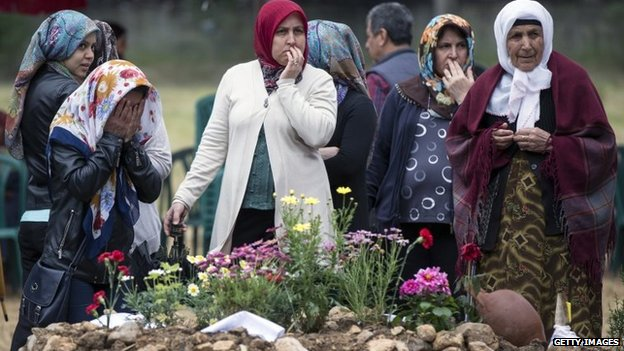 Friends and relatives of the miners who died in an explosion at the Soma mine pray in Soma cemetery following the burial of further bodies recovered from the mine in Soma, Turkey, 17 May 2014