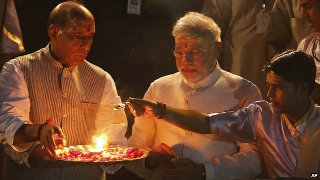 Mr Modi performs a religious ritual in Varanasi
