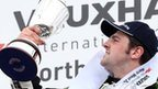 Michael Dunlop holds aloft the trophy after his Superbike win