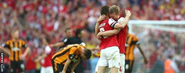 Arsenal's Laurent Koscielny and Per Mertesacker celebrate