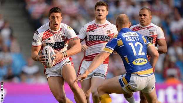 Wigan's Anthony Gelling looks to get past Carl Ablett of Leeds