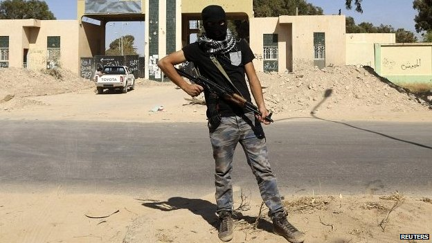 A gunman stands guard at the militia camp attacked by Khalifa Haftar's forces in Benghazi - 16 May 2014