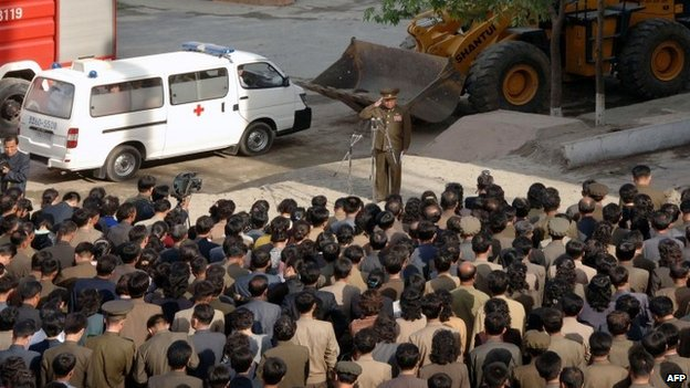 A construction division officer (top) apologising to residents following the 13 May serious accident in the construction site of an apartment house in Phyongchon district, Pyongyang (May 2014)