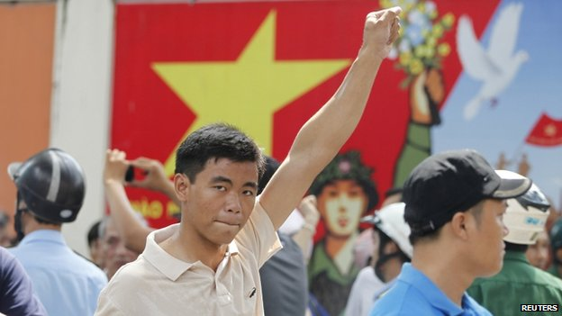 A protester gestures as he marches during an anti-China protest in Vietnam's southern Ho Chi Minh City on 18 May 2014