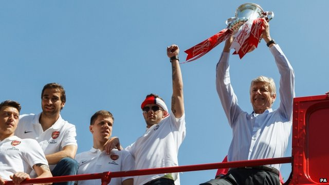 Arsene Wenger holding the trophy