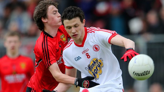 Ronan Miller of Down in action against Tyrone opponent Ronan Nugent