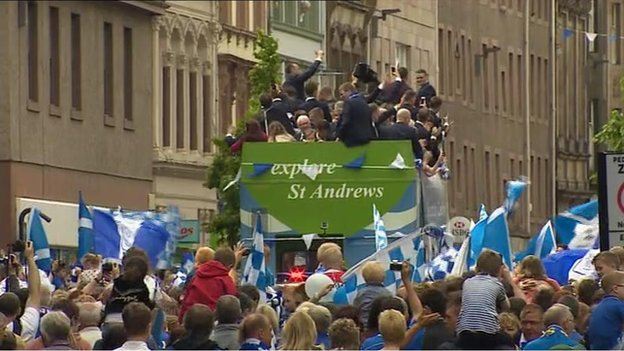 Thousands of people have lined the route of the bus parade