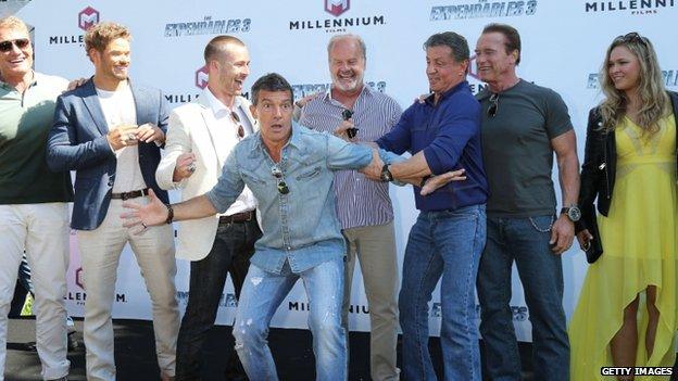 Dolph Lundgren, Kellan Lutz, Glen Powell, Antonio Banderas, Kelsey Grammer, Sylvester Stallone, Arnold Schwarzenegger and Ronda Rousey